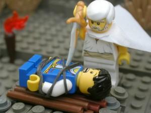 イサクに刃物を突き付けるアブラハム(The Brick Testament より)
